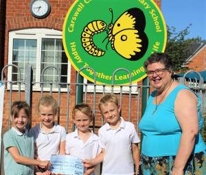 Carswell children present cheque to TrinityLearning